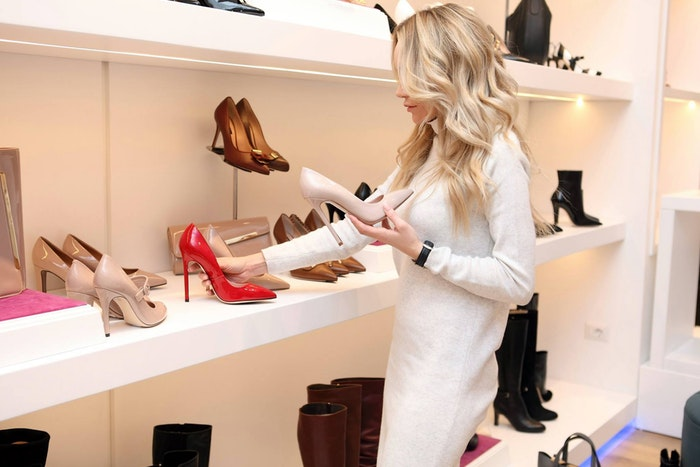 woman shopping for shoes for Christmas