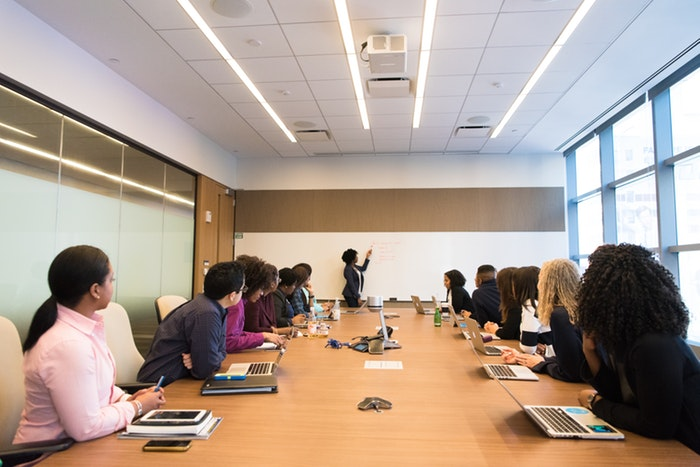 marketers generating insights and predictions at a meeting